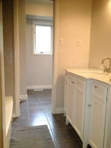 Fresh paint, new ceramic floor tiles, updated vanity and fixtures.